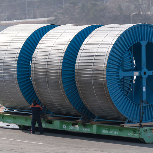 Taihan subsea cable drums on a roll trailer