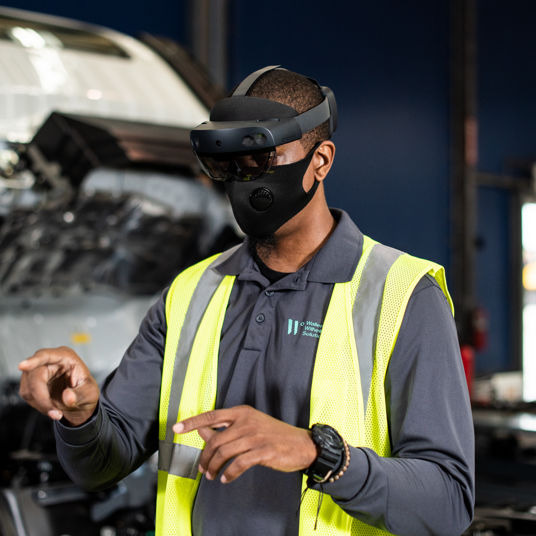 Vehicle processing employee uses Microsoft HoloLens technology